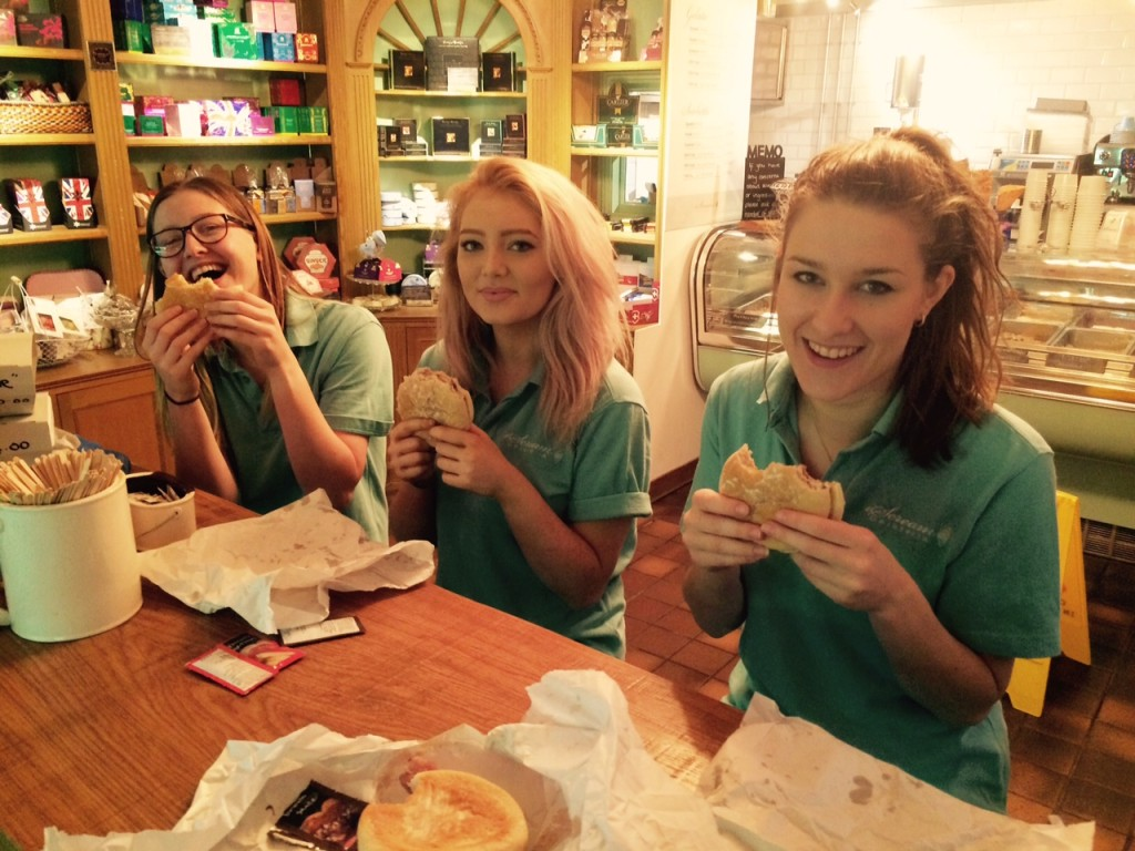 The team enjoying their bacon rolls before a busy day ahead