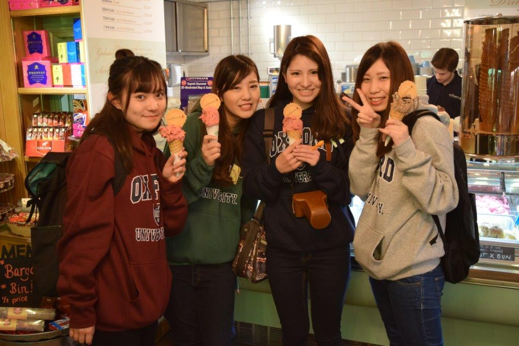 It may be cold and wet outside but that didn't put these four Japanese girls off