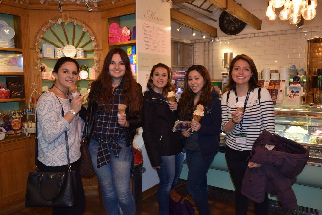 Five lovely Mexican girls enjoying gelato on a Spring day