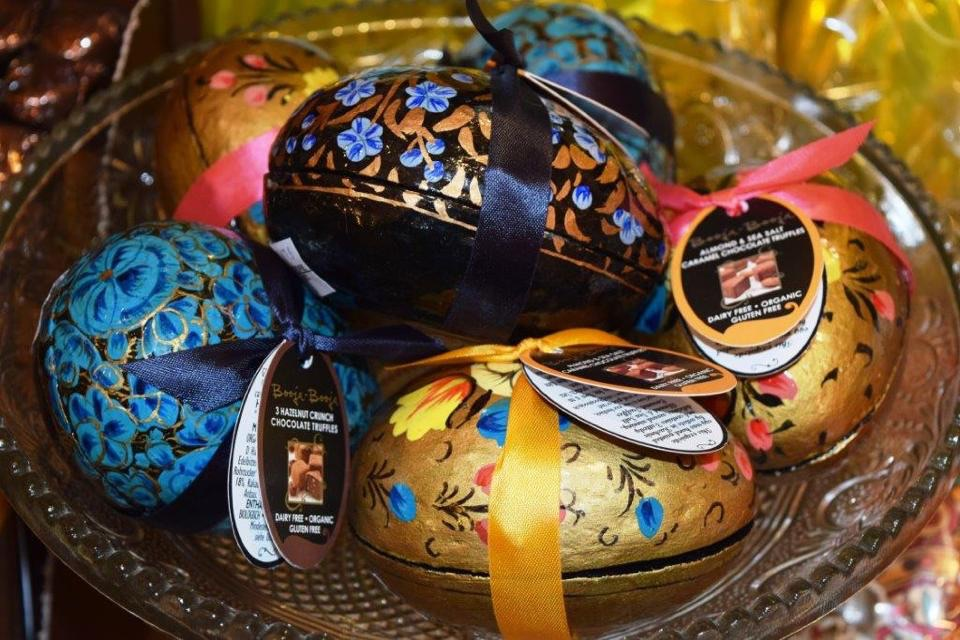These exquisite Booja Booja eggs are hand painted by a community of artists called 'The Persian Dowry' living and working in Kashmir. The delicious truffles inside the eggs are handmade in Norfolk using carefully chosen organic ingredients from the four corners of the earth