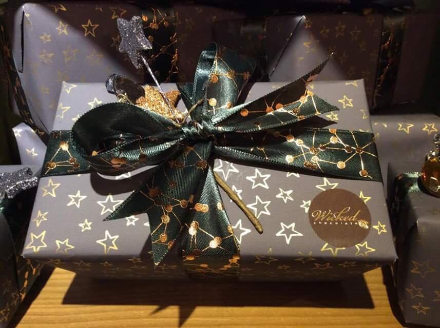We are thoroughly enjoying hand picking our finest 'Wicked' chocolates for you and yours, delicately wrapping them in our new festive paper and adorning them with little touches we adore - we hope you will love them too!